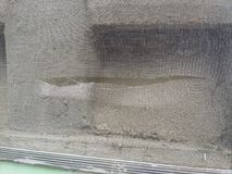 Cut Window Screen. This window screen was vandalized by some sort of cutting instrument royalty free stock photos