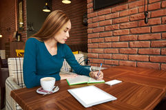 Cut woman lawyer is using digital table,. Proud businesswoman with portable touch pad is waiting in coffee shop business meeting Royalty Free Stock Photography