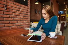 Cut woman lawyer is using digital table,. Young elegant female skilled managing director is reading e-mail on digital tablet positive feedback from the client Royalty Free Stock Images