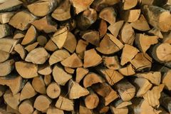 Cut wood background applied in pile royalty free stock images