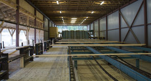 Cut Wood Planks on Conveyor in Sawmill Royalty Free Stock Image
