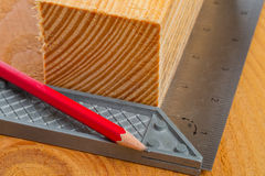 Cut wood with try square and pencil Royalty Free Stock Image
