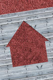 Cut wooden boards forming house with red texture Royalty Free Stock Photography