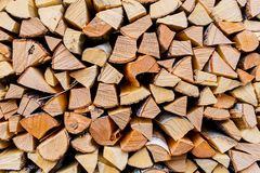 Cut wooden logs texture. Wooden background. Pieces of wood in th royalty free stock image