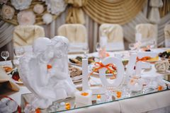 Cut the word love with white angels and candles on the table bri Royalty Free Stock Image