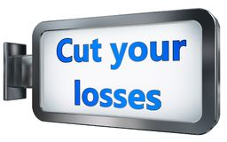 Cut your losses on billboard background. Cut your losses wall light box billboard background , isolated on white Royalty Free Stock Image