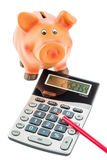 Cutbacks, piggy bank and calculator Stock Photo