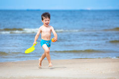 Cute 4 years old boy running on tropical beach Stock Images