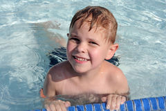 Cute 6-year-old boy in pool Stock Photos