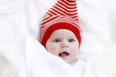 5c07f022d4c Cute adorable baby child with Christmas winter cap on white background.  Happy baby girl or