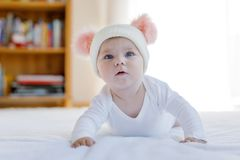 Cute adorable baby child with warm white and pink hat with cute bobbles Royalty Free Stock Photo