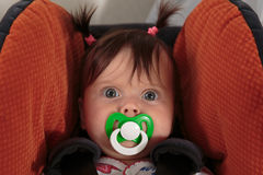 Cute adorable baby girl with baby`s dummy Royalty Free Stock Photo