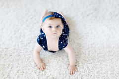 Cute adorable baby girl in blue clothes and headband. Stock Image