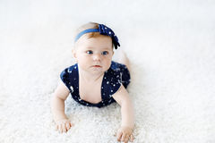Cute adorable baby girl in blue clothes and headband. Stock Images