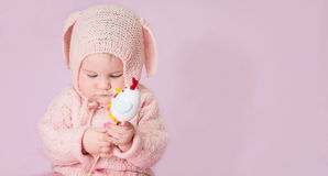 Cute adorable baby girl closeup portrait in knitted costume of E royalty free stock images