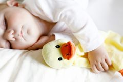 Cute adorable baby girl of 6 months sleeping peaceful in bed Royalty Free Stock Photography