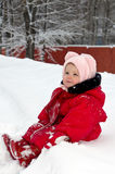 Cute adorable baby sitting on snow Royalty Free Stock Images