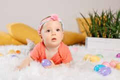 Baby girl celebrating Easter holiday Royalty Free Stock Photos