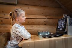 Free Cute Adorable Caucasian Little Blond Girl Sitting At Desk With Laptop During Online Video Chat School Lesson Session With Teacher Royalty Free Stock Photos - 178031288