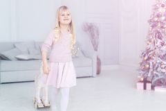 Free Cute Adorable Caucasian Little Blond Smiling Girl Portrait Enjoy Playing Rocking Horse Near Christmas Tree At Home Indoors. Happy Royalty Free Stock Photography - 163339947