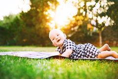 Cute  adorable child baby boy lying on the grass on nature Royalty Free Stock Photo