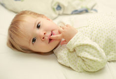 Cute adorable child in bed Stock Photography