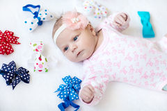 Cute adorable newborn baby child with colorful bows Stock Images