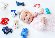 Cute adorable newborn baby child with colorful bows Royalty Free Stock Photo