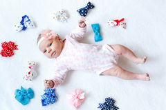 Cute adorable newborn baby child with colorful bows Royalty Free Stock Photos