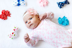 Cute adorable newborn baby child with colorful bows Royalty Free Stock Photography