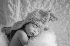 Cute and adorable newborn baby with costume sleeping Stock Photography