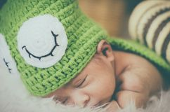 Cute and adorable newborn baby with costume sleeping Royalty Free Stock Photos