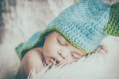 Cute and adorable newborn baby with costume sleeping Royalty Free Stock Photo