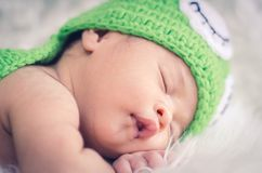 Cute and adorable newborn baby with costume sleeping Stock Photos