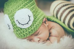 Cute and adorable newborn baby with costume sleeping Stock Photo