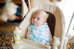 Cute adorable newborn baby sitting in swing Royalty Free Stock Photo