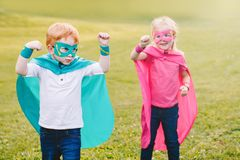 Preschool Caucasian children playing superheroes royalty free stock photo