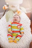 Cute adorable smiling white Caucasian baby boy girl lying in bouncer chair. stock photo