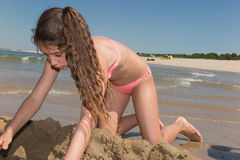 Cute and adorable teenager having fun on the beach. Stock Photography