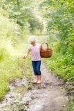 Blonde preschool little girl picking fresh edible mushrooms Stock Images