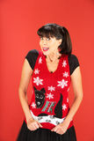Cute adult female in ugly Christmas sweater Stock Image