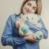 Cute adult girl with plush bear Stock Image
