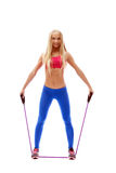 Cute aerobics instructor posing with skipping rope Royalty Free Stock Image