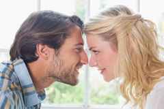 Cute affectionate couple facing each other Stock Images
