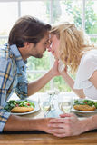Cute affectionate couple having a meal together Royalty Free Stock Photo