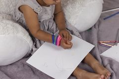 Beautiful cute girl enjoying painting stock photos