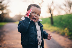 Cute African American Boy. Playing with Mobile Phone Stock Photo