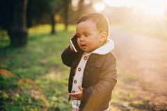 Cute African American Boy. Playing with Mobile Phone Royalty Free Stock Image