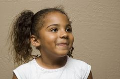 Cute african american child. Smiling, looking to the left Stock Photo