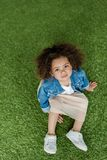 Cute african american curly girl resting stock images